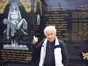 Dad standing in front of one of the political murals in Belfast