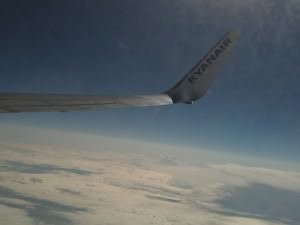 Ryanair plane above the clouds, tips on flying discount airlines