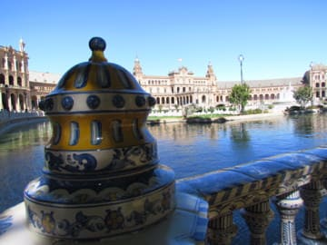The Plaza de España in Seville, Spain is an architectural wonder. Discount carriers like Ryanair easily and affordably connect Seville with the rest of Europe. how to book the cheapest flight