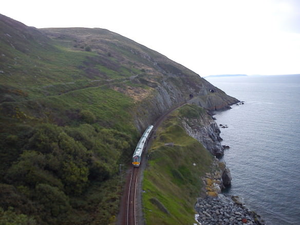 train going along the track on a cliff near Bray