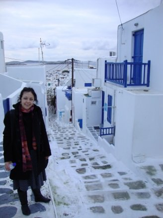 Bell in the lane-way of Mykonos with white and blue houses