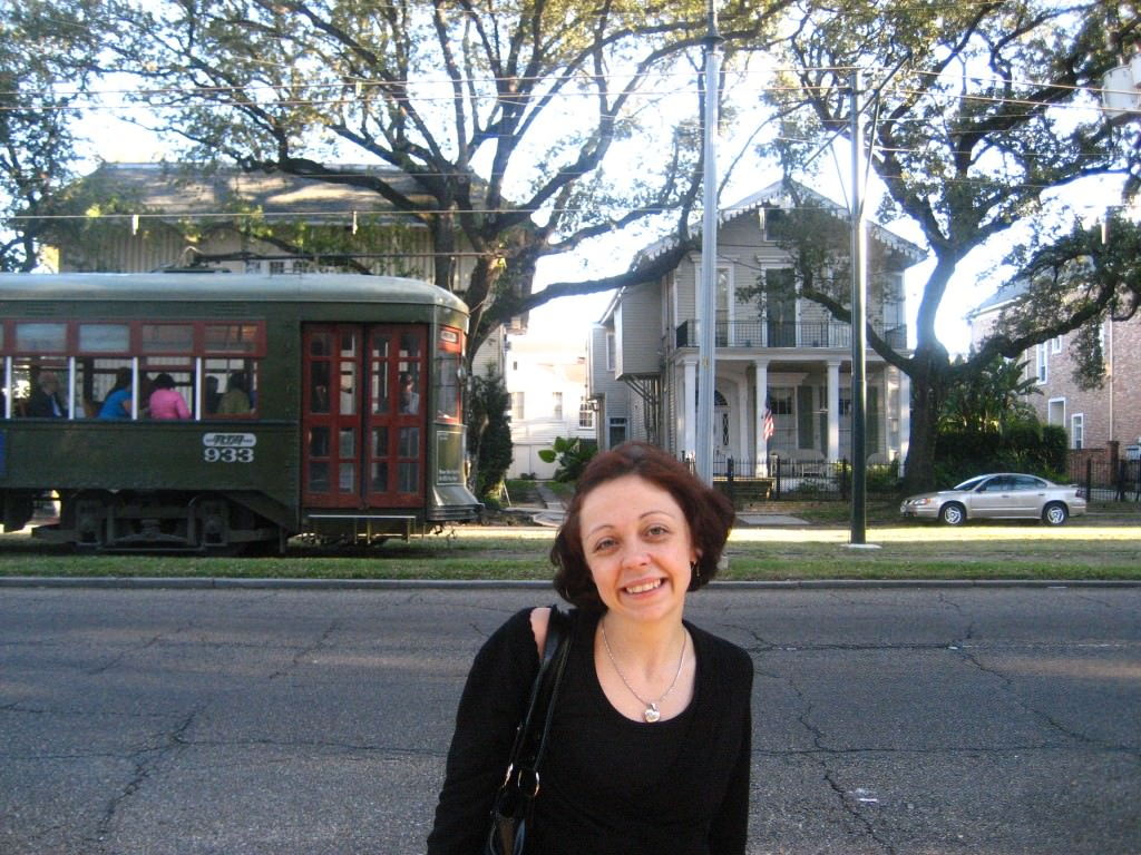Bell poses as an old street car rolls through the Garden District, New Orleans.