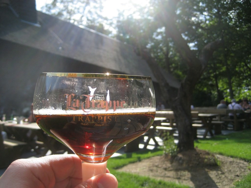 Sun light shines from the heavens into the beer on the terrace of the de Koningshoeven cafe, the La Trappe brewery