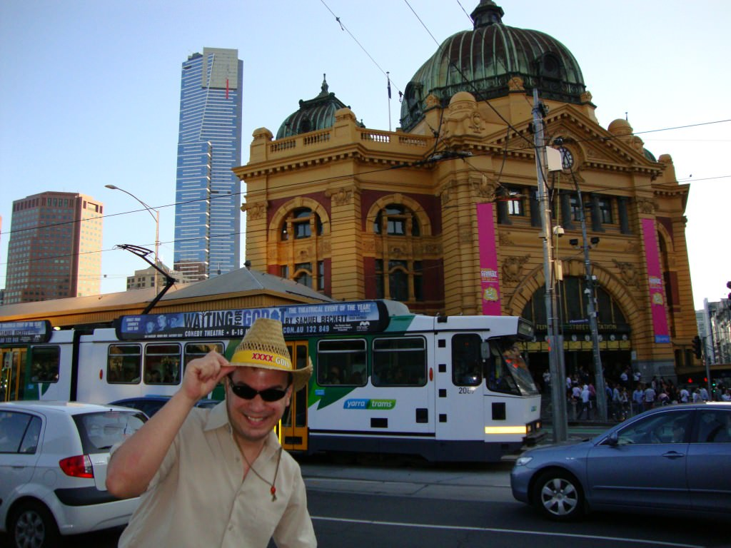 "Melbourne, Australia...saving money to travel' as ""Hawk Reynolds,"" cattle rancher from Texas, down under to check out the big city."