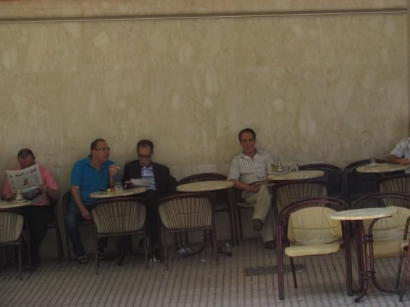 Moroccan men lounge in a cafe in Tangier