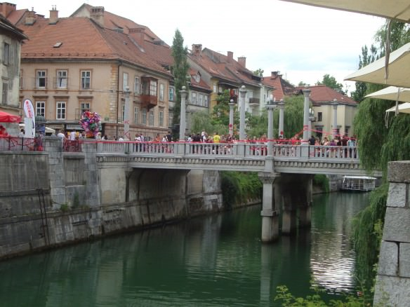 The beautiful green colored Ljubljana River  dissects the center of Ljubljana, Slovenia. mainstream travel advice
