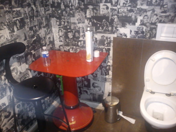 table and chair in toilet in France