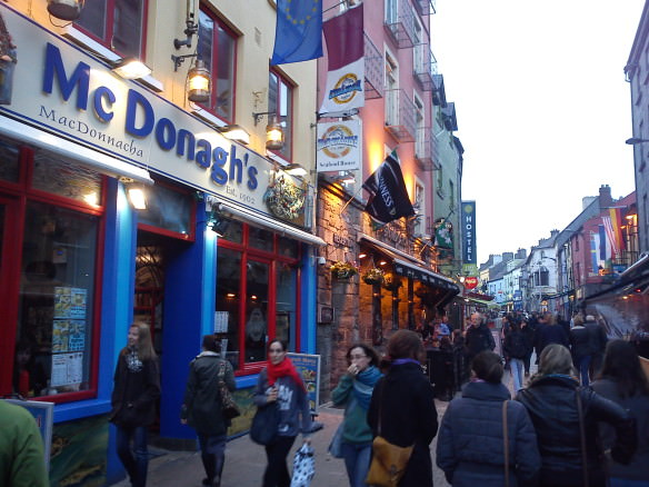 Quay Street in Galway with many people walking down the street