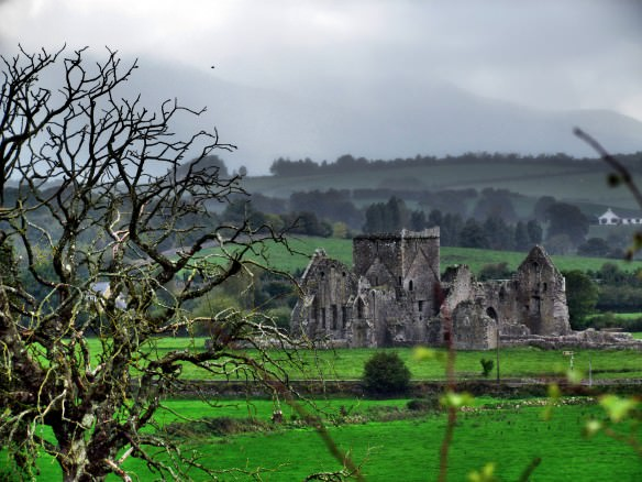 Rock of Cashel, with green rolling hills and misty sky