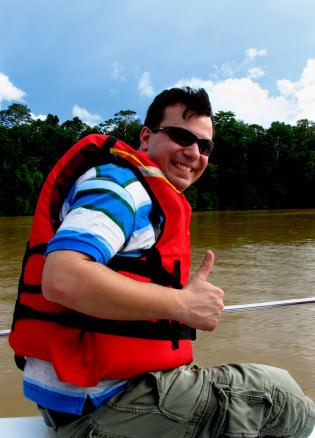 Alex on a boat along the Kinabatangan