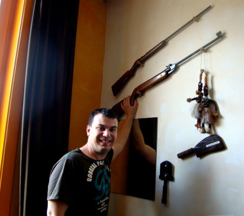 Alex and the guns in our safari themed room, Brugge, Belgium