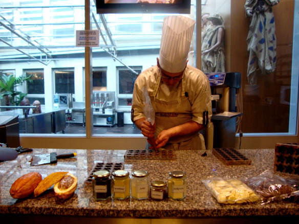 Guy making Belgian chocolates