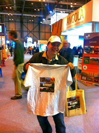 Alex with his Angola freebies - FITUR