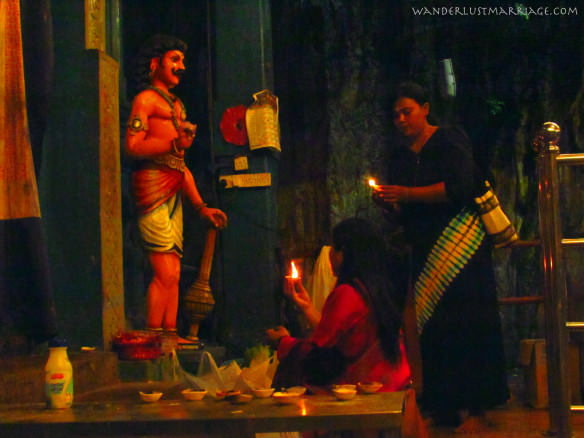 Praying inside the Batu Caves