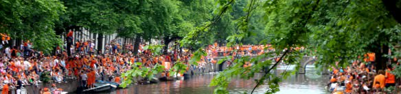 Dutch in Orange on Canal Bridge