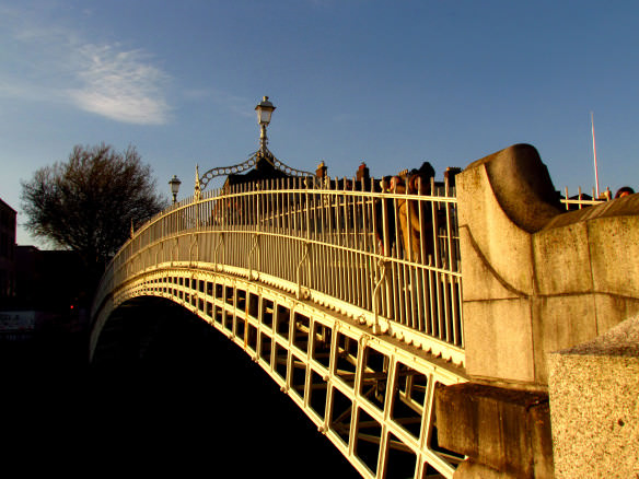 H'penny bridge in Dublin with blue skies