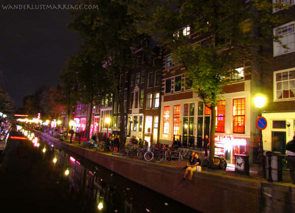 Canal houses in the red light district of Amsterdam at night