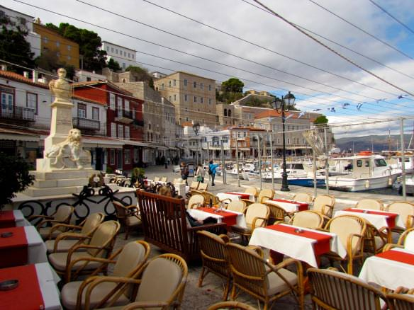 Cafe seating by the harbor in Hydra