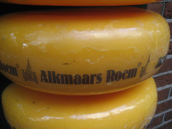 large cheese wheels stacked in Alkmaar
