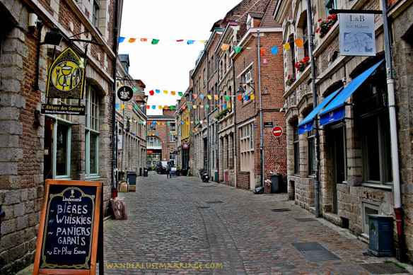 A charming street in Lille, France lined with bars and restaurants