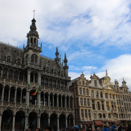 partly cloudy sky over Town Hall in Brussels' Grand Place