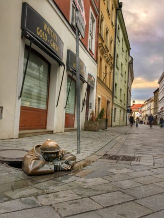 Man in a street hole - sculpture in the streets