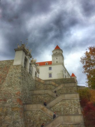 Bratislava castle with stormy skies and autumn leafs