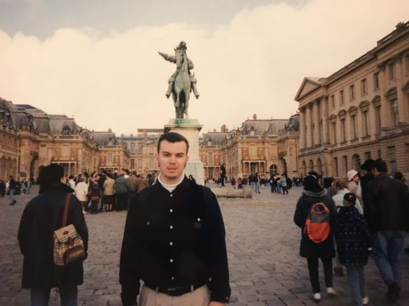 Alex in Paris 20 years in front of a statue of Napoleon