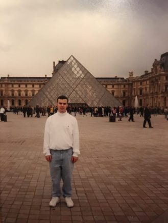Alex in front of the Louvre Paris