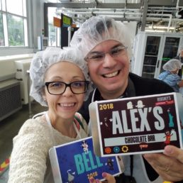 Alex & Bell with their chocolate bars in the build your own chocolate bar factory