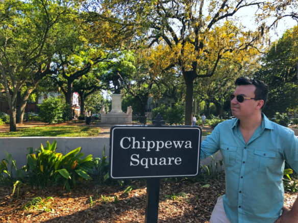 Alex posing with the Chippewa Square sign in Savannah, Georgia