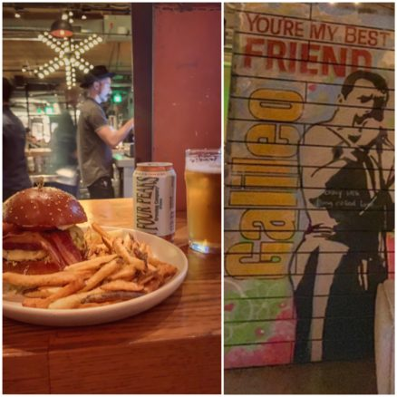 burger and fries with a beer and art in the bar