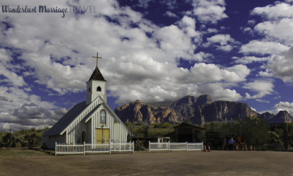 Elvis church with mountain backdrop and fluffy white clouds