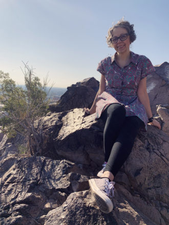 Bell sitting on some rocks on A Mountain in Tempe
