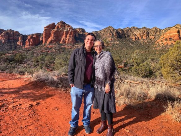 Alex and Bell along a trail in Sedona and the red rocks