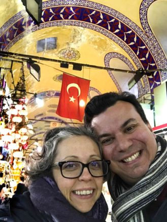 Alex & Bell selfie inside the Istanbul bazaar market with lamps in the background