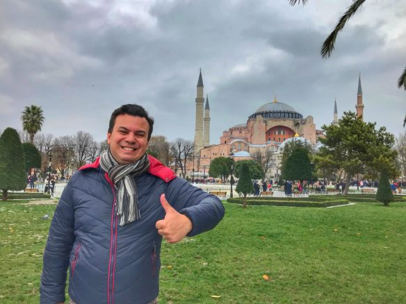 Alex in Istanbul with a mosque behind him