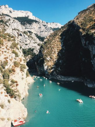 Gorges du Verdon with boats docked in the sea and blue skies