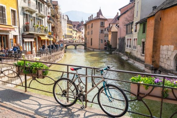 Bike leaning up against the bridge of canal in Annecy