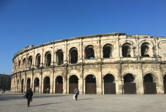 colossal Nimes Arena with blues skies