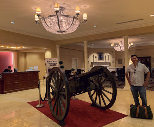 Alex in the hotel lobby with a civil war canon in Gettysburg