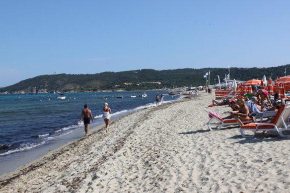 Beach with sun umbrellas in StTropez