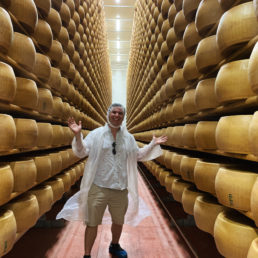 Alex with wall to wall parmesan cheese wheels