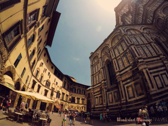 The Dumo cathedral and cafes on the opposite side of street in Florence