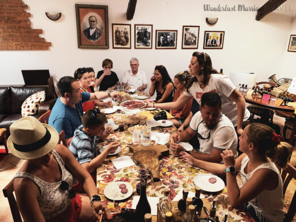 Tour group around a table tasting balsamic vinegar