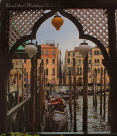 Guy sitting in his gondola in Venice, Italy