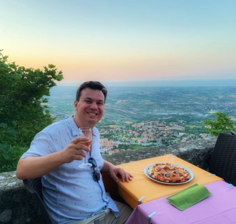 Alex with pizza and wine with San Marino