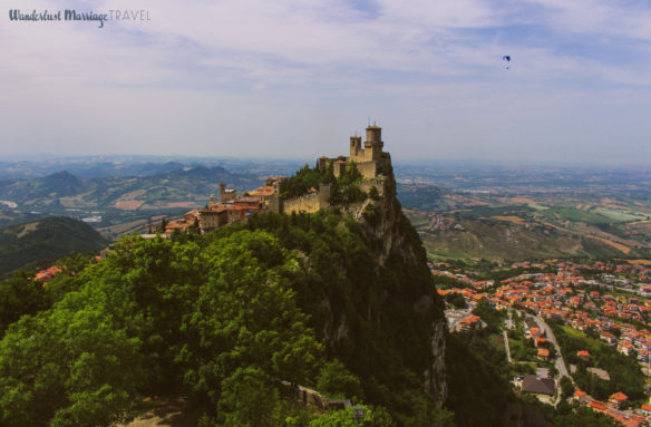 San Marino fort and mountains with a glider in the sky