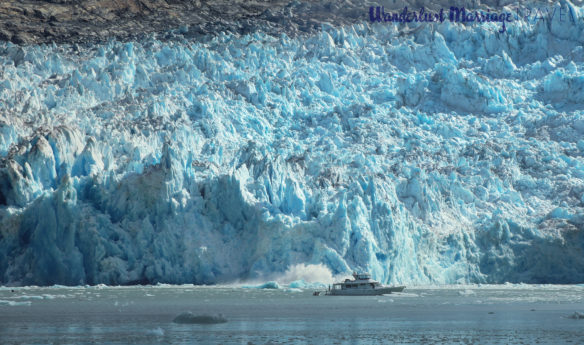 Part of the glacier falling into the sea and creating a large splash