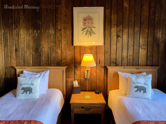 Cozy hotel bed in a log cabin